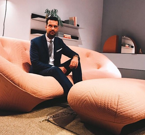 Antoine Roset, the fifth generation owner of Ligne Roset, sits on the reissued Bonnie sofa during IMM Cologne.